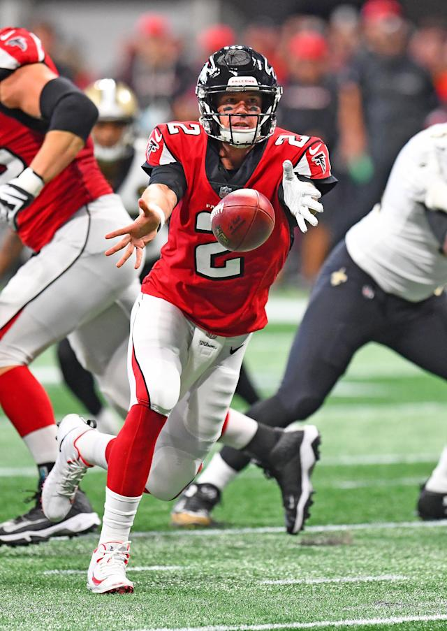 <p>Matt Ryan #2 of the Atlanta Falcons tosses the ball back in the first half against the New Orleans Saints at Mercedes-Benz Stadium on September 23, 2018 in Atlanta, Georgia. (Photo by Scott Cunningham/Getty Images) </p>