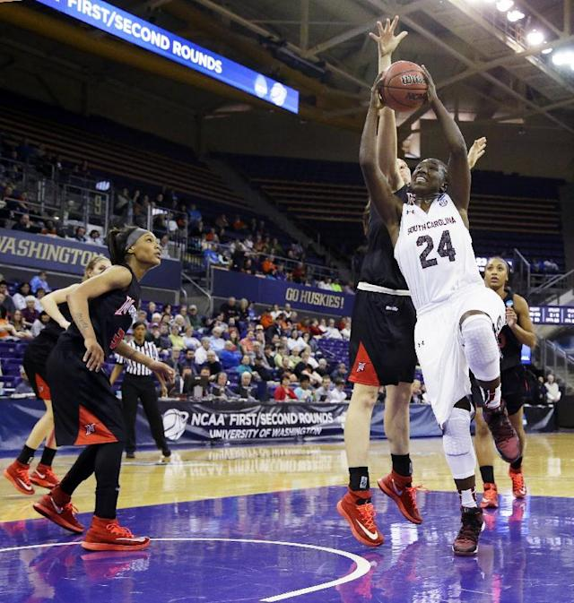 South Carolina's Aleighsa Welch puts up a shot against Cal State Northridge in the first half of a first-round game in the NCAA women's college basketball tournament, Sunday, March 23, 2014, in Seattle. (AP Photo/Ted S. Warren)