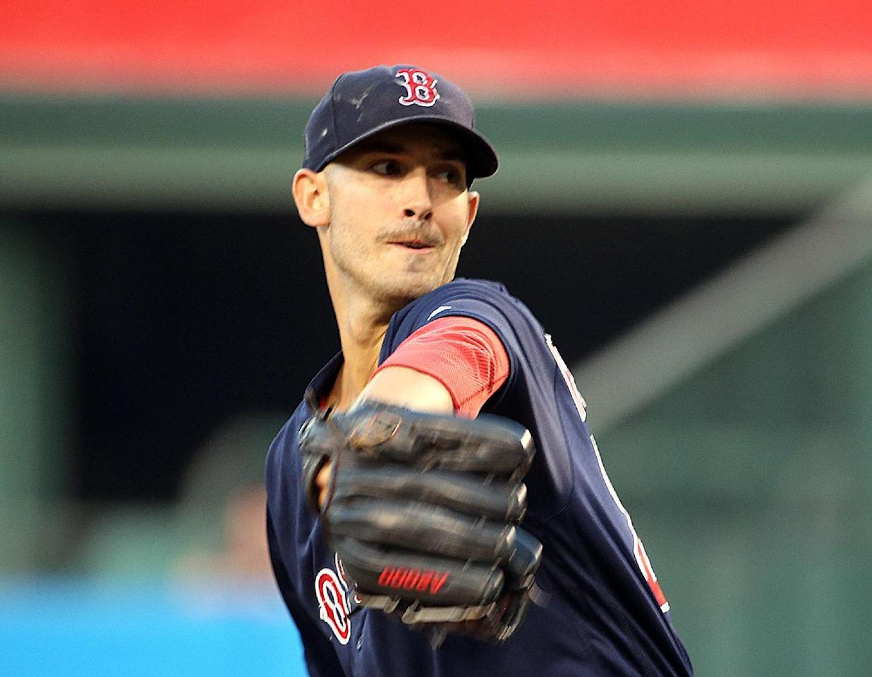 Boston Red Sox starter Rick Porcello pitches to the Los Angeles Angels in the first inning of a baseball game in Anaheim, Calif., Friday, July 29, 2016. (AP Photo/Reed Saxon)