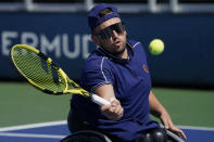 Dylan Alcott, of Australia, returns to Bryan Barten, of the United States, during a men's wheelchair quad quarterfinals match at the U.S. Open tennis tournament in New York, Friday, Sept. 10, 2021, in New York. (AP Photo/John Minchillo)
