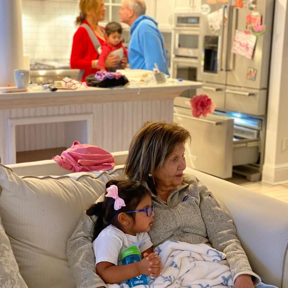 <p>There's nothing like cuddling up to your grandma while at home with your family.</p>