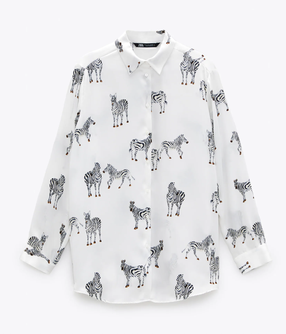 """<p><strong>ZARA</strong></p><p>zara.com</p><p><strong>$39.90</strong></p><p><a href=""""https://www.zara.com/us/en/animal-print-satin-effect-top-p02852261.html"""" rel=""""nofollow noopener"""" target=""""_blank"""" data-ylk=""""slk:Shop It"""" class=""""link rapid-noclick-resp"""">Shop It</a></p><p>Wear this zebra printed silk top with a pair of khaki Bermuda shorts when you're in the mood for adventure. It's still acceptable if you're limited to exploration in your own backyard.</p>"""