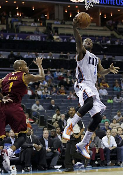 Charlotte Bobcats' Kemba Walker, right, drives past Cleveland Cavaliers' Jarrett Jack, left, in the first half of a preseason NBA basketball game in Charlotte, N.C., Thursday, Oct. 24, 2013. (AP Photo/Chuck Burton)