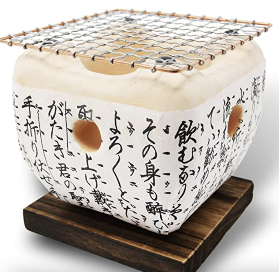PHOTO: Amazon. Table-top Konro with Wire mesh Grill and Wooden Base