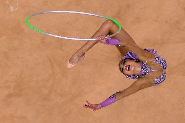 LONDON, ENGLAND - AUGUST 11:  Yeon Jae Son competes during the Individual All-Around Rhythmic Gymnastics final on Day 15 of the London 2012 Olympics Games at Wembley Arena on August 11, 2012 in London, England.  (Photo by Richard Heathcote/Getty Images)