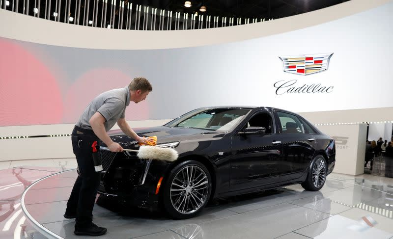 FILE PHOTO: A worker polishes a Cadillac CT6 V-Sport at the New York Auto Show in New York in 2018