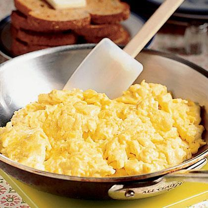 """<p>Spice up the traditional scrambled <a href=""""https://www.myrecipes.com/egg-recipes/"""" rel=""""nofollow noopener"""" target=""""_blank"""" data-ylk=""""slk:egg"""" class=""""link rapid-noclick-resp"""">egg</a> recipe by adding in a little <a href=""""https://www.myrecipes.com/ingredients/chicken-recipes/chicken-broth-recipes"""" rel=""""nofollow noopener"""" target=""""_blank"""" data-ylk=""""slk:chicken broth"""" class=""""link rapid-noclick-resp"""">chicken broth</a> to the mixture. Side this breakfast staple with fruit and turkey bacon for a healthy start to the day.</p>"""