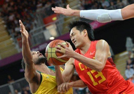 Chinese guard Chen Jianghua vies with Australian guard Patrick Mills (left) during the men's preliminary round Group B basketball match of the London 2012 Olympic Games at the basketball arena in London. France took a major step toward reaching the medal playoffs in the Olympic men's basketball tournament by beating Lithuania 82-74 and Australia boosted playoff hopes by ripping China 81-61