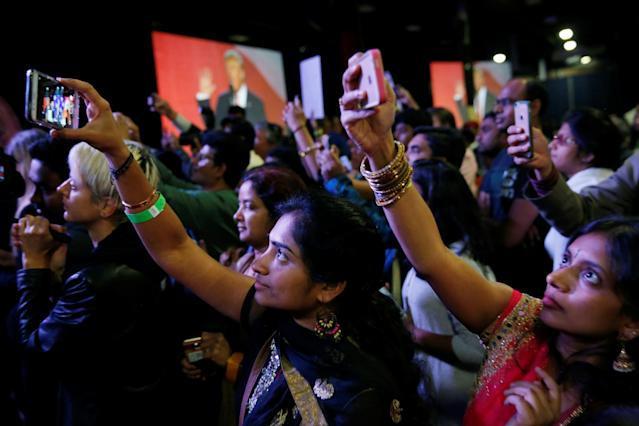 Attendees watch Republican presidential nominee Donald Trump speak at a Bollywood-themed charity concert put on by the Republican Hindu Coalition in Edison, New Jersey, U.S. October 15, 2016. REUTERS/Jonathan Ernst
