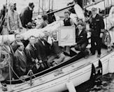 <p>Franklin Roosevelt takes a ride on the presidential yacht in Massachusetts in 1933.</p>