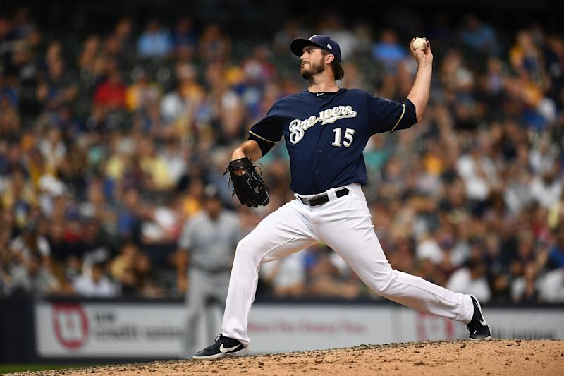 Padres get Davies, Grisham from Brewers for Uras, Lauer