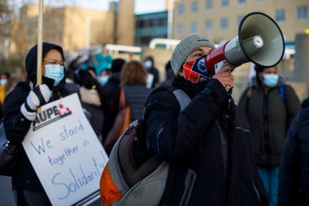 Royal Alexandra Hospital front-line workers walk a picket line after walking off the job in a wildcat strike in Edmonton on Oct. 26, 2020.