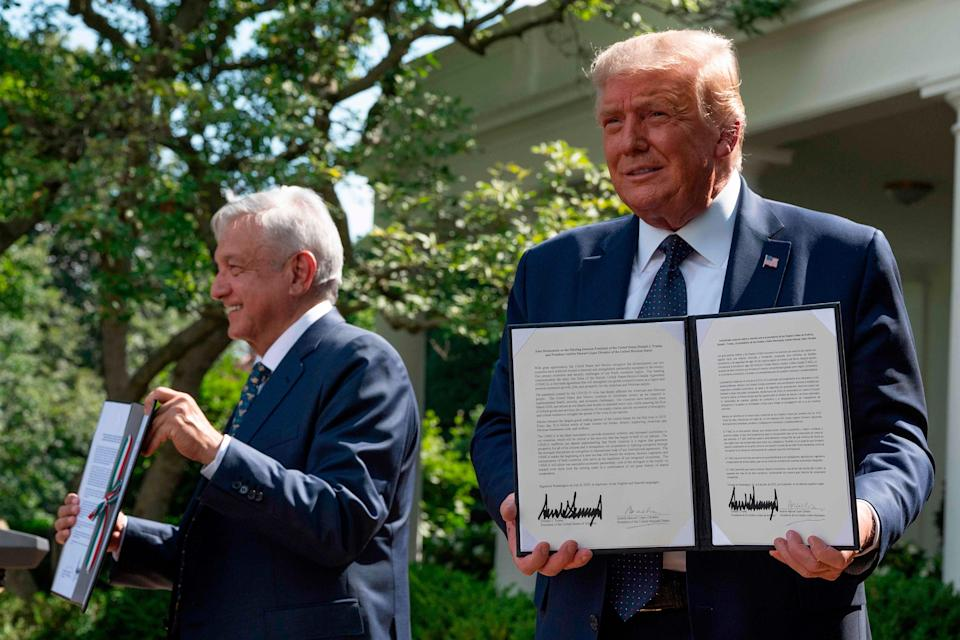 US President Donald Trump and Mexican President Andres Manuel Lopez Obrador hold up a joint declaration during a joint press conference in the Rose Garden of the White House on July 8, 2020, in Washington, DC.