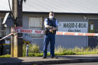 Police stand outside a mosque in Auckland, New Zealand, Saturday, Sept. 4, 2021. New Zealand authorities say they shot and killed a violent extremist, Friday Sept. 3 after he entered a supermarket and stabbed and injured six shoppers. Prime Minister Jacinda Ardern described Friday's incident as a terror attack. (AP Photo/Brett Phibbs)