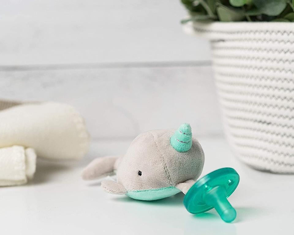 """<p>Not only does this <a href=""""amazon.com/WubbaNub-Infant-Pacifier-Marnie-Narwhal/dp/B08H7FSXJR/"""" class=""""link rapid-noclick-resp"""" data-ylk=""""slk:WubbaNub Pacifier"""">WubbaNub Pacifier</a> ($18) look cute, but it also act as a weight, which means you'll be popping that paci back in a lot less.</p>"""