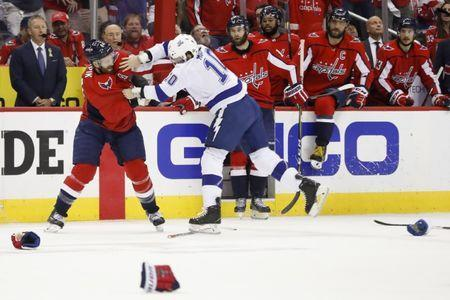 May 21, 2018; Washington, DC, USA; Washington Capitals defenseman Brooks Orpik (44) and Tampa Bay Lightning center J.T. Miller (10) fight during the first period in game six of the Eastern Conference Final in the 2018 Stanley Cup Playoffs at Capital One Arena. Mandatory Credit: Geoff Burke-USA TODAY Sports