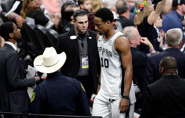 Spurs guard DeMar DeRozan (10) leaves the court when he was ejected with five minutes remaining after arguing with an official over an offensive foul during the second half Saturday. (AP Photo/Eric Gay)