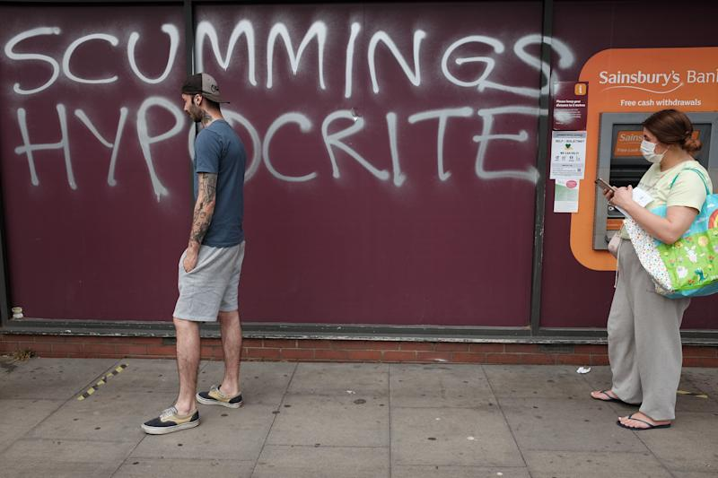 Graffiti protesting against Dominic Cummings is sprayed on a supermarket wall near his north London home, the day after he a gave press conference over allegations he breached coronavirus lockdown restrictions. (Photo: PA)