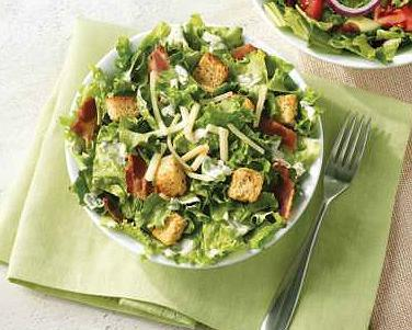 """<p>If you're looking for something healthy to munch on during your next Timmies run, perhaps forgo the Caesar. This salad (with dressing) features crispy green leaf lettuce and is topped with bacon, seasoned croutons and a four cheese blend – but at 24 g of fat ( 7 g saturated) it's the<strong> second most fattening item on the menu</strong> (in terms of total fat grams). With 830 mg of sodium, it's even unhealthier than their BLT sandwich (15 g fat/770 mg sodium).<br><br><strong>Serving size: 137 g</strong><br>— Calories: 310 <br>— Fat: 24 g (Saturated Fat 7 g)<br>— Carbohydrates: 14 g <br>— Sodium: 830 mg <br>— Sugar: 3 g <br>— Protein: 11 g<br>— Source/Photo: <a href=""""http://www.timhortons.com/ca/en/pdf/Tim_Hortons_Nutrition_Guide_-_Canada_English.pdf"""" rel=""""nofollow noopener"""" target=""""_blank"""" data-ylk=""""slk:Tim Hortons Canada"""" class=""""link rapid-noclick-resp"""">Tim Hortons Canada<br></a><br><strong>TRY THIS INSTEAD:</strong> Tim Hortons garden salad with dressing (Fat: 11 g/Sat. Fat: 1 g/Sodium: 310 mg) </p>"""