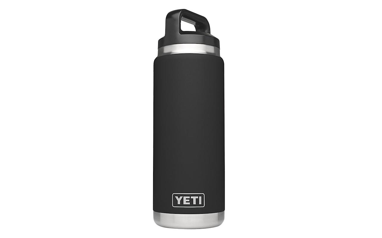"""<p>Ensure the travel lover in your life stays hydrated on the road with this <a href=""""https://www.amazon.com/YETI-Rambler-Insulated-Stainless-DuraCoat/dp/B072BV47Q8/ref=as_li_ss_tl?ie=UTF8&linkCode=ll1&tag=tltravelgiftideasrcarhart0919-20&linkId=731285d0713f0e6e24cd0fced49c2f86&language=en_US"""" target=""""_blank"""">insulated YETI rambler</a>. It features a double-wall vacuum insulation that keeps hot drinks hot and cold drinks cold for hours. The 26-ounce bottle also comes in 12 different colors, so it will be easy to find an option that suits their style. </p> <p>To buy: <a href=""""https://www.amazon.com/YETI-Rambler-Insulated-Stainless-DuraCoat/dp/B072BV47Q8/ref=as_li_ss_tl?ie=UTF8&linkCode=ll1&tag=tltravelgiftideasrcarhart0919-20&linkId=731285d0713f0e6e24cd0fced49c2f86&language=en_US"""" target=""""_blank"""">amazon.com</a>, $40</p>"""