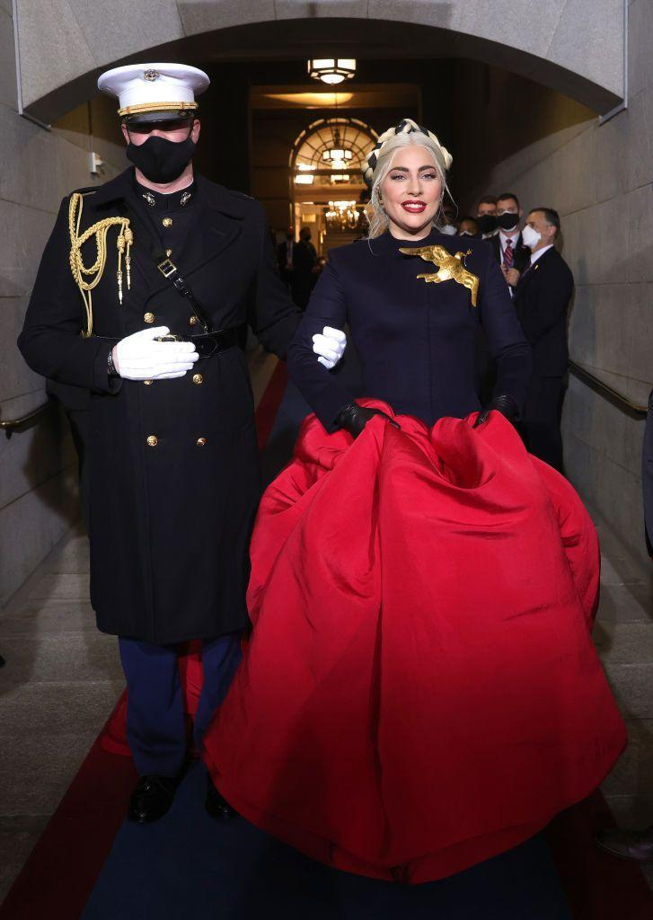<p>The 34-year-old chose a powerful Schiaparelli Haute Couture gown to perform 'The Star-Spangled Banner', paired with a large golden dove brooch.</p>