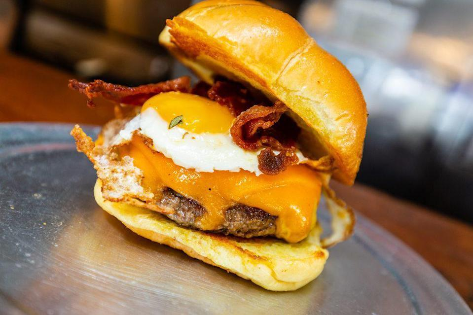 "<p>Since 2001, Cheeseburger Baby has been ""keeping it classic"" with cheeseburgers that have attracted the likes of <a href=""https://www.theactivetimes.com/featured/top-song-year-you-were-born?referrer=yahoo&category=beauty_food&include_utm=1&utm_medium=referral&utm_source=yahoo&utm_campaign=feed"" rel=""nofollow noopener"" target=""_blank"" data-ylk=""slk:popular song hitmaker"" class=""link rapid-noclick-resp"">popular song hitmaker</a> and Grammy-award winning rapper Jay-Z. Owned by Stephanie ""Queen of South Beach"" Vitori, Cheeseburger Baby is famous for being the only female-owned burger joint in Miami. Favorites at Cheeseburger Baby include The Original — a half-pound cheeseburger that can be topped with anything from onion rings to chili — and Baby's Favorite — The Original topped with applewood smoked bacon, cheddar cheese and a fried egg.</p>"