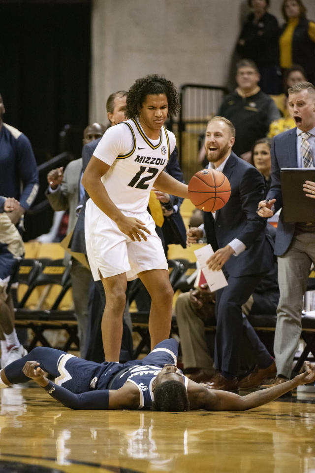 Missouri's Dru Smith, top, stands over Charleston Southern's Dontrell Shuler, bottom, after Shuler was called for a foul during the first half of an NCAA college basketball game Tuesday, Dec. 3, 2019, in Columbia, Mo. (AP Photo/L.G. Patterson)