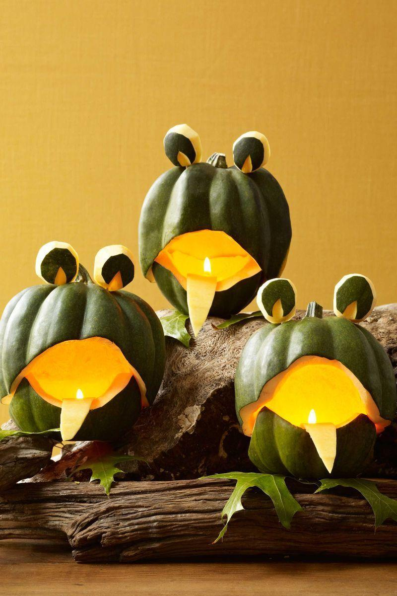 "<p>Cut each acorn squash in half crosswise, curving upward for a mouth. Carve out the bottom of the mouth (save some rind for the eyes); smooth the edges with a peeler (use a shaving as the tongue). Reassemble the parts with toothpicks, and set on top of leaf feet.</p><p>Decide which side of the squash will be the front (choose the best-shaped or -colored side). Carve off the bottom third of the squash, cutting it so that it curves upward in the front (save some rind for the eyes). Separate the pieces and scoop out the seeds. Carve the mouth curve 1"" to 2"" higher on the top piece, using a <span class=""redactor-unlink"">vegetable peeler</span> afterward to smooth out the edges.</p><p>Cut about 1/2"" all around the bottom piece, then carve a curve another 1"" to 2"" at the front for the bottom of the mouth. Carve away at both top and bottom pieces until they rest nicely to resemble an upper and lower jaw. Smooth with a vegetable peeler (keep a peeling for the tongue). Press several half-toothpicks into the back and sides of the bottom rind; place top of squash onto the bottom so that its edges overlap. Press to secure.</p><p>Cut out round eyes from extra rind. Scoop out eye pupils with a vegetable peeler, then use half-toothpicks to stick the eyes onto the top of the gourd. Place squash on top of leaf feet and use discarded rind peel to form tongue; secure from inside using a toothpick. (Repeat the steps above to make the Frog Choir.)</p>"