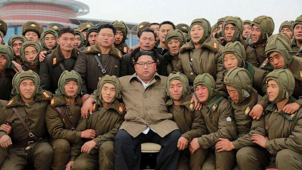 PHOTO: In this undated photo provided on Monday, Nov. 18, 2019, by the North Korean government, Kim Jong Un, center, poses with North Korean air force sharpshooters and soldiers for a photo at an unknown location in North Korea. (Korean Central News Agency/Korea News Service via AP)
