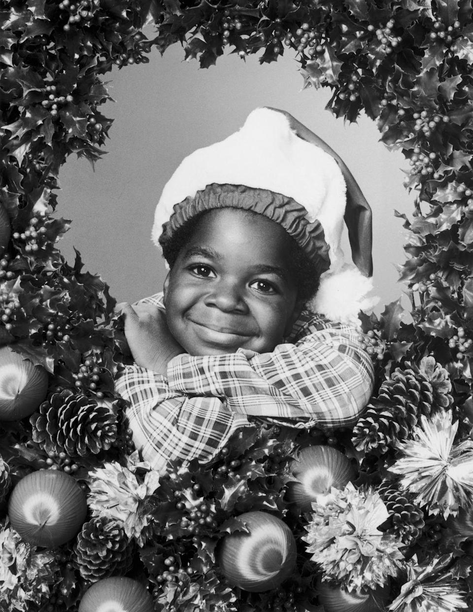 <p>Gary Coleman posed inside a Christmas wreath in 1979, wearing a plaid flannel shirt and a Santa hat. The <em>Diff'rent Strokes </em>star was all smiles for the upcoming holiday season.</p>
