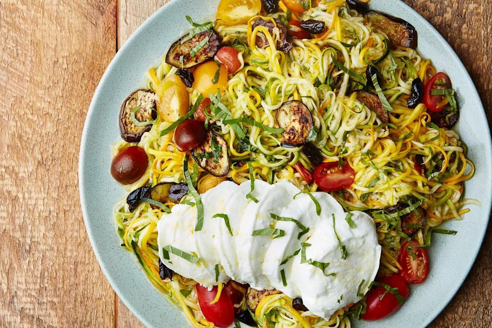 """If you somehow ended up with too much zucchini, add this ratatouille-inspired dinner to your meal plan. Fresh mozzarella contributes a bit of creamy richness to the dish. <a href=""""https://www.epicurious.com/recipes/food/views/zucchini-noodles-with-eggplant-and-tomatoes?mbid=synd_yahoo_rss"""" rel=""""nofollow noopener"""" target=""""_blank"""" data-ylk=""""slk:See recipe."""" class=""""link rapid-noclick-resp"""">See recipe.</a>"""