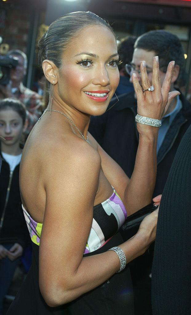 """Jennifer Lopez flashes the engagement ring Ben Affleck gave her in 2003 at the premiere of his movie """"Daredevil."""" (Photo: Kevin Winter/Getty Images)"""