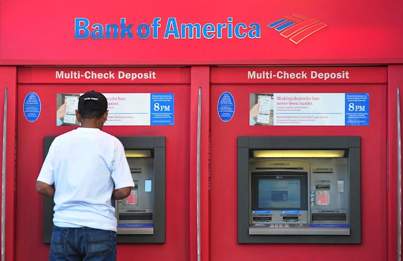A man withdraws cash from a Bank of America automated teller machine (ATM) in Hollywood, California on October 24, 2012 (AFP Photo/Frederic J. Brown)