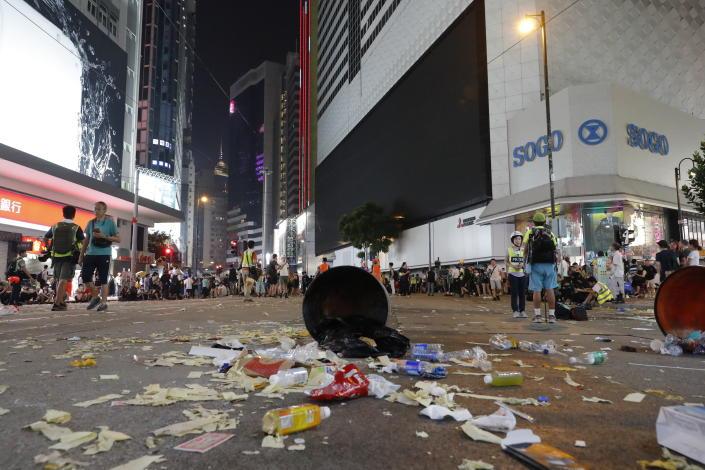 Protestors sit on a littered street in Hong Kong, Oct. 1, 2019. (Photo: Vincent Thian/AP)