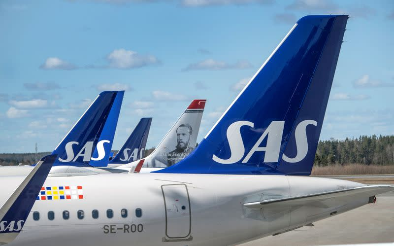 FILE PHOTO: Scandinavian Airlines (SAS) planes are pictured at the Arlanda airport, north of Stockholm