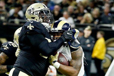 Nov 27, 2016; New Orleans, LA, USA;  New Orleans Saints defensive tackle Nick Fairley (90) tackles Los Angeles Rams running back Todd Gurley (30) for a loss during the fourth quarter of a game at the Mercedes-Benz Superdome.  Mandatory Credit: Derick E. Hingle-USA TODAY Sports