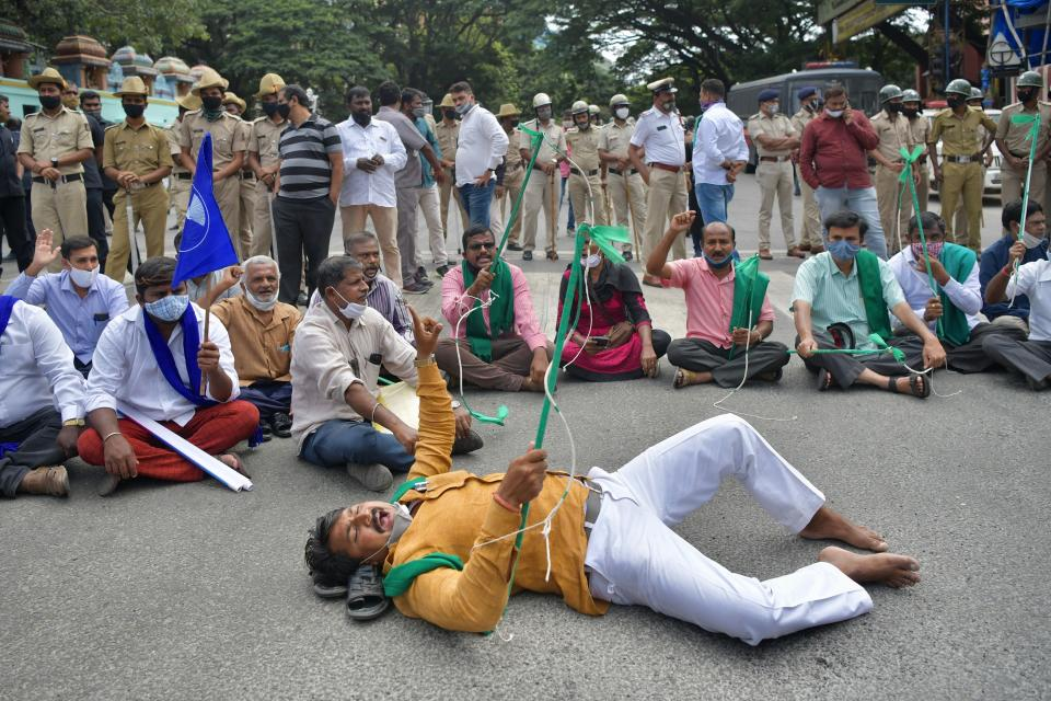 Activists from various farmers rights organisations stage a protest following the recent passing of agriculture bills in the Lok Sabha (lower house), in Bangalore on September 25, 2020. - Angry farmers took to the streets and blocked roads and railways across India on September 25, intensifying protests over major new farming legislation they say will benefit only big corporates. (Photo by Manjunath Kiran / AFP) (Photo by MANJUNATH KIRAN/AFP via Getty Images)
