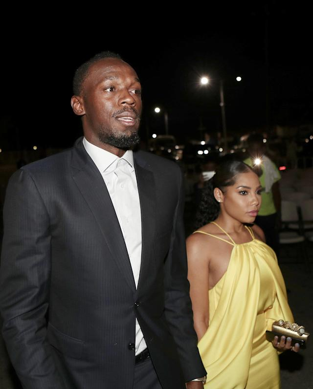 Olympic champion Usain Bolt (L) arrives with his girlfriend Kasi Bennett for the unveiling of his statue at the Statue Park at the National Stadium, in Kingston, Jamaica December 3, 2017. REUTERS/Gilbert Bellamy