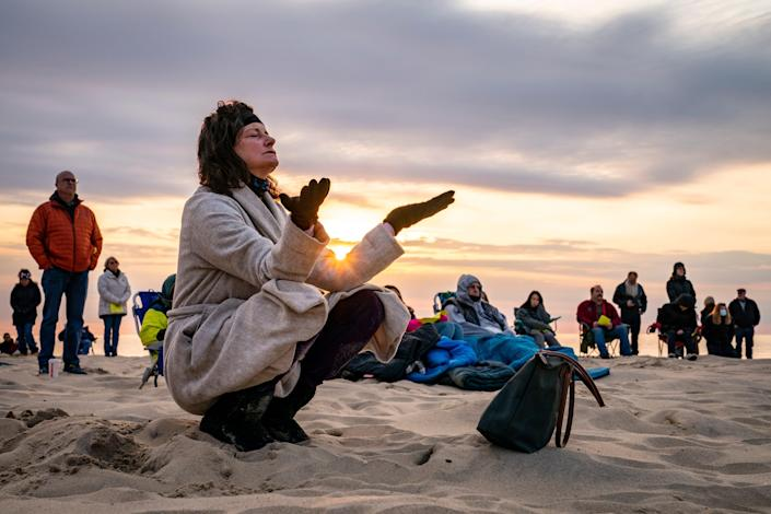 Parishioners gather on a beach April 4 for an Easter Sunday service at sunrise hosted by Hope Community Church in Manasquan, N.J.
