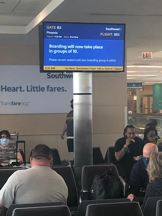 A sign in the gate area at Chicago's Midway Airport details Southwest's new boarding procedure. It is designed to encourage social distancing.