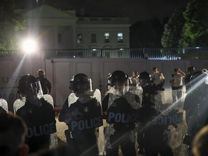 Demonstrators hold a protest in response to the police killing of George Floyd in Lafayette Square Park near the White House on 29 May 2020 in Washington, DC: (2020 Getty Images)