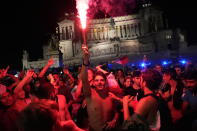 Italy's fans celebrate in Rome, Monday, July 12, 2021, after Italy beat England to win the Euro 2020 soccer championships in a final played at Wembley stadium in London. Italy beat England 3-2 in a penalty shootout after a 1-1 draw. (AP Photo/Alessandra Tarantino)