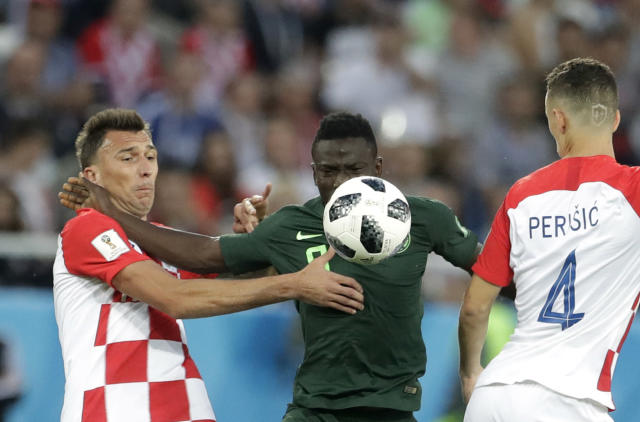 <p>No inch given: Mario Mandzukic and Oghenekaro Etebo fight for possession in Kalingrad. (AP) </p>