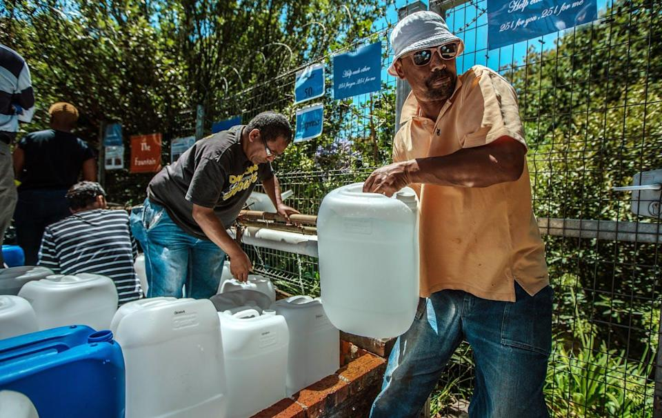 "<span class=""caption"">Cape Town residents queued up for water as the taps nearly ran dry in 2018.</span> <span class=""attribution""><a class=""link rapid-noclick-resp"" href=""https://www.gettyimages.com/detail/news-photo/cape-town-residents-queue-to-refill-water-bottles-at-news-photo/913638526"" rel=""nofollow noopener"" target=""_blank"" data-ylk=""slk:Morgana Wingard/Getty Images"">Morgana Wingard/Getty Images</a></span>"