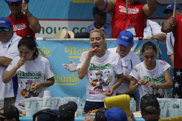 <p>Miki Sudo (C) competes to win the women Annual Nathan's Hot Dog Eating Contest at the neighborhood of Coney Island on July 4, 2018 in New York City. (Photo: Eduardo Munoz Alvarez/Getty Images) </p>