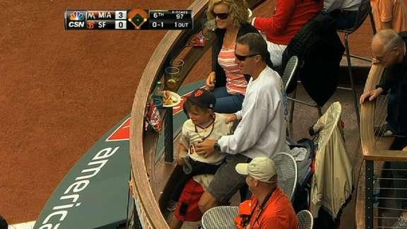 Boy has violent reaction after missing foul ball