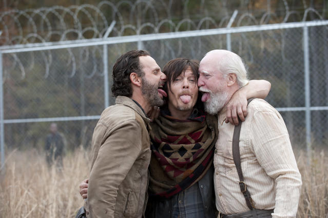 <p>Andy Lincoln and Norman Reedus give a Reedus-type salute with fan and cast favorite Scott Wilson on the prison set.<br><br>(Photo: AMC) </p>