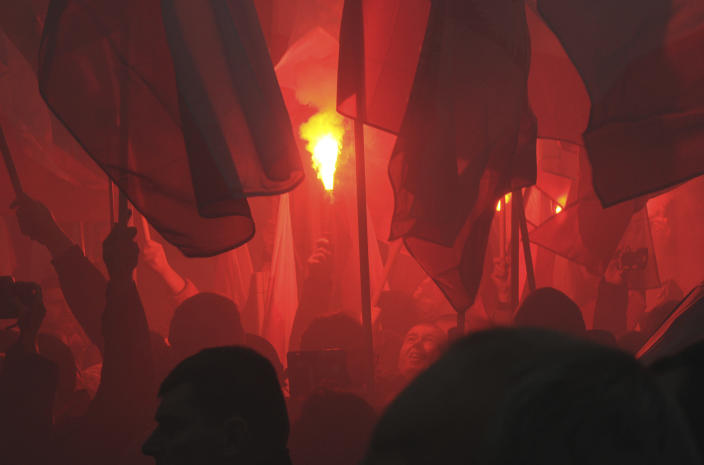 Marchers burn flares during the annual March of Independence organized by far right activists to celebrate 100 years of Poland's independence marking the nation regaining its sovereignty at the end of World War I after being wiped off the map for more than a century. (AP Photo/Alik Keplicz)
