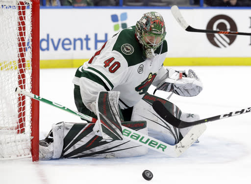 Minnesota Wild goaltender Devan Dubnyk (40) makes a save on a shot by the Tampa Bay Lightning during the second period of an NHL hockey game Thursday, March 7, 2019, in Tampa, Fla. (AP Photo/Chris O'Meara)
