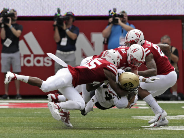 Colorado wide receiver Jay MacIntyre (14) is tackled by Nebraska defensive back Antonio Reed (25), defensive back Lamar Jackson (21) and linebacker Luke Gifford (12) during the first half of an NCAA college football game in Lincoln, Neb., Saturday, Sept. 8, 2018. (AP Photo/Nati Harnik)